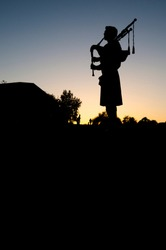 Bagpiper at sunset on golf course