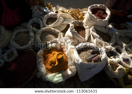 Bags containing spices and dry beans for sale at a market