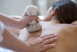Bags massage. Young dark-haired woman having bags ayurvedic massage