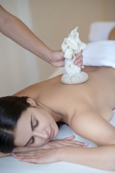 Bags massage. Young woman having ayurvedic massage in the salon