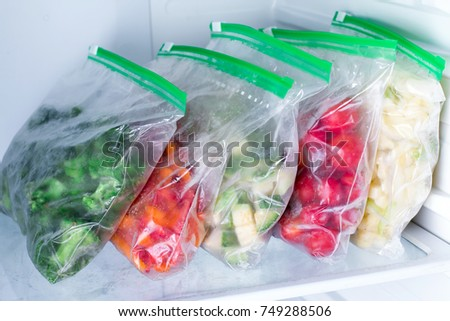 Bags with frozen vegetables in refrigerator #749288506