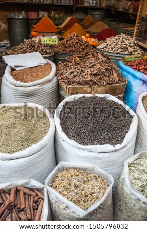 Bags with seeds, dried fruits and spices outdoor the spices market