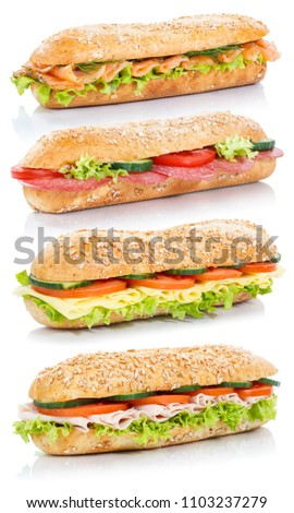 Baguette sub sandwiches with salami ham cheese salmon fish stacked whole grains fresh isolated on a white background #1103237279