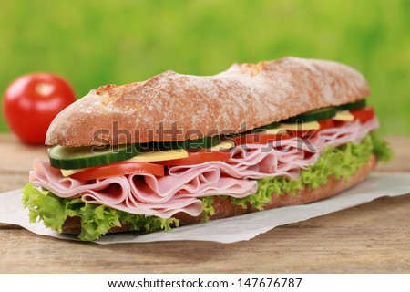 Baguette with ham, cheese, tomatoes, cucumber and lettuce