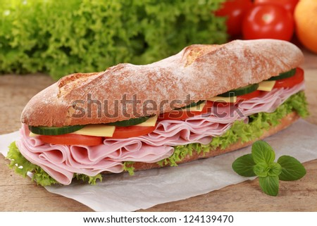 Baguette with ham, cheese, tomatoes, lettuce and cucumber