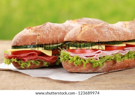 Baguettes with pepperoni, ham, cheese, tomatoes, lettuce and cucumber