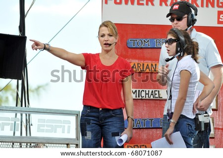 "BAHAMAS, CARIBBEAN - DECEMBER 4:  ESPN's  ""SportsNation"" television show host Michelle Beadle (L), with film crew members, broadcasts live on Dec. 4, 2010 on location at Paradise Island in the Bahamas, Caribbean."