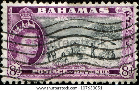 BAHAMAS - CIRCA 1954: A stamp printed in Bahamas shows Queen Elizabeth II and peoples on the beach, circa 1954