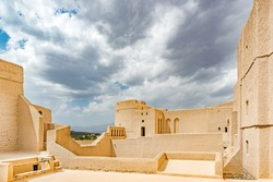 Bahla Fort in Ad Dakhiliyah, Oman. It is located about 40 km away from Nizwa and about 200 km from Muscat the capital. It has led to its designation as a UNESCO World Heritage Site in 1987.
