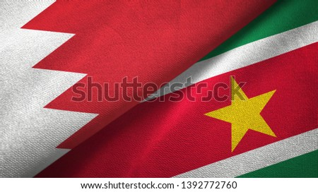 Bahrain and Suriname two flags textile cloth, fabric texture #1392772760