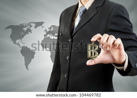 Baht symbol in businessman hand