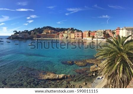 Baia del Silenzio, Sestri Levante, Liguria, Italy. Transparent water and colourful buildnings.