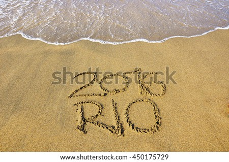 BAIA DOMIZIA, ITALY, JULY 3, 2016: Rio 2016 message on the beach approached by waves #450175729