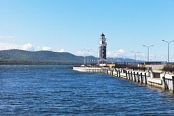 Baika Lake at summer sunny dayl. View from water on lighthouse at the entrance to the