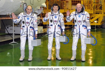 BAIKONUR KAZAKHSTAN DECEMBER 9 ISS 31 crew L-R Don Petit Oleg Kononenko Andre Kuipers pose for pictures following a fit check at Baikonur Cosmodrome December 9 2011 Baikonur Kazakhstan