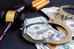 Bail bond. Corruption. Gavel, handcuffs and money.