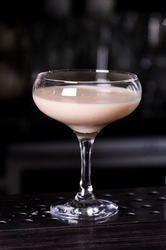 Baileys liqueur in glass on dark background. bar alcohol cocktail menu Milk liqueur. evening, club, concept