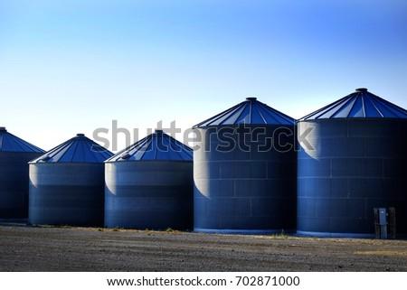Bain silos on farm for farming and storage of wheat