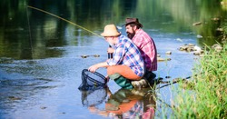 Bait and hook. Hobby and recreation. Good catch. Bearded men fishing. Family day. Lucky and skilled. Catching fish with friend. Friends catch fish. Fellow fishermen. Spinners and tackle. Nice catch.