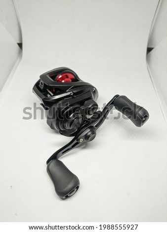 Bait Casting Reel, usually for fishing predator fish such as bass, toman, etc Imagine de stoc ©