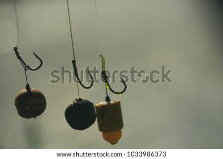 Baits, hooks, sinkers preparing for carp fishing. #1033986373