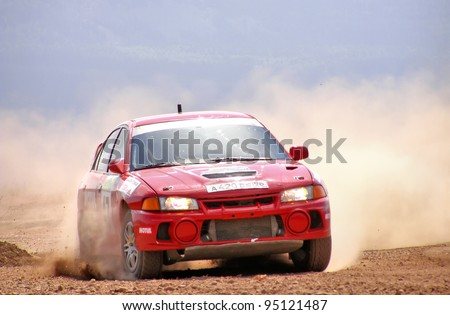 BAKAL, RUSSIA - AUGUST 3: Andrey Rybakov's Mitsubishi Lancer Evolution IV (No. 47) competes at the annual Rally Southern Ural on August 3, 2007 in Bakal, Satka district, Chelyabinsk region, Russia.