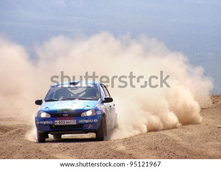 BAKAL, RUSSIA - AUGUST 3: Andrey Vasilyev's Lada Kalina (No. 34) competes at the annual Rally Southern Ural on August 3, 2007 in Bakal, Satka district, Chelyabinsk region, Russia.