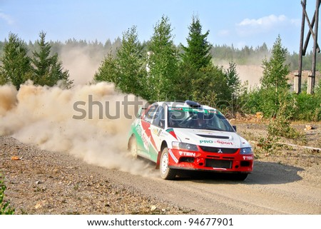 """BAKAL, RUSSIA - AUGUST 13: Andrey Zhigunov's Mitsubishi Lancer Evo IX WRC No. 2 competes at the annual rally """"Southern Ural"""" on August 13, 2010 in Bakal, Satka district, Chelyabinsk region, Russia."""