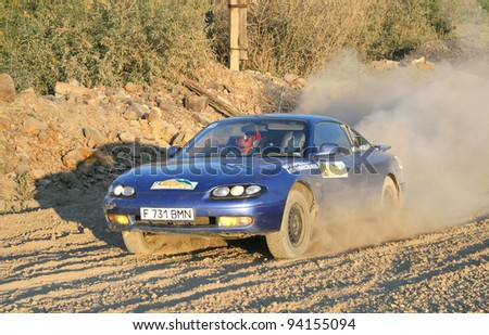BAKAL, RUSSIA - AUGUST 13: Igor Melnikov's Mazda MX-6 (No. 74) competes at the annual Rally Southern Ural on August 13, 2010 in Bakal, Satka district, Chelyabinsk region, Russia.