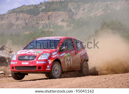 BAKAL, RUSSIA - AUGUST 3: Irek Dautov's Citroen C2 (No. 21) competes at the annual Rally Southern Ural on August 3, 2007 in Bakal, Satka district, Chelyabinsk region, Russia.