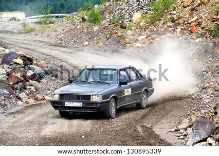 BAKAL, RUSSIA - AUGUST 21: Konstantin Berezin's Audi 80 (No. 59) competes at the annual Rally Southern Ural on August 21, 2012 in Bakal, Satka district, Chelyabinsk region, Russia.