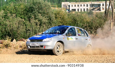 BAKAL, RUSSIA - AUGUST 13: Maxim Aronov's LADA Kalina (No. 36) competes at the annual Rally Southern Ural on August 13, 2010 in Bakal, Satka district, Chelyabinsk region, Russia.