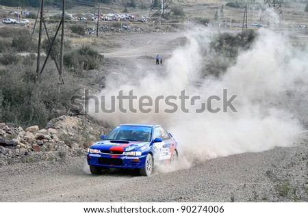 BAKAL, RUSSIA - AUGUST 13: Sergey Savin's Subaru Impreza (No. 19) competes at the annual Rally Southern Ural on August 13, 2010 in Bakal, Satka district, Chelyabinsk region, Russia.