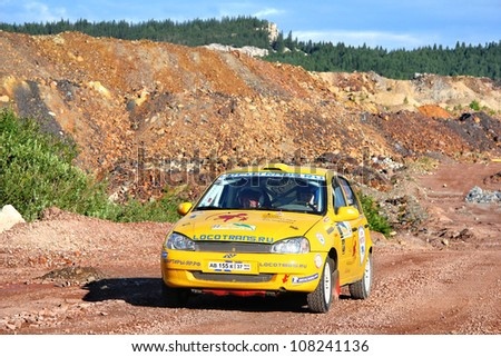 BAKAL, RUSSIA - JULY 21: Alexey Petrov's Lada Kalina (No. 22) competes at the annual Rally Southern Ural on July 21, 2012 in Bakal, Satka district, Chelyabinsk region, Russia.