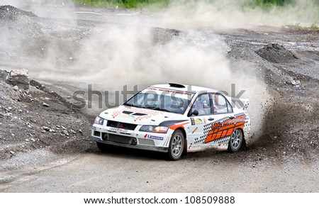 BAKAL, RUSSIA - JULY 21: Andrey Trukhin's Mitsubishi Lancer Evo VII (No. 1) competes at the annual Rally Southern Ural on July 21, 2012 in Bakal, Satka district, Chelyabinsk region, Russia.