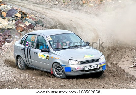 BAKAL, RUSSIA - JULY 21: Andrey Volkov's Lada Kalina (No. 60) competes at the annual Rally Southern Ural on July 21, 2012 in Bakal, Satka district, Chelyabinsk region, Russia.