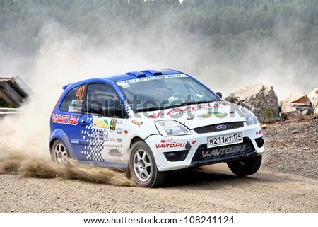 BAKAL, RUSSIA - JULY 21: Maxim Aronov's Ford Fiesta (No. 40) competes at the annual Rally Southern Ural on July 21, 2012 in Bakal, Satka district, Chelyabinsk region, Russia.