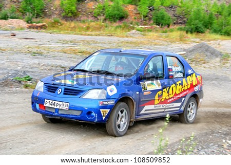 BAKAL, RUSSIA - JULY 21: Oleg Myslevich's Renault Logan (No. 32) competes at the annual Rally Southern Ural on July 21, 2012 in Bakal, Satka district, Chelyabinsk region, Russia.