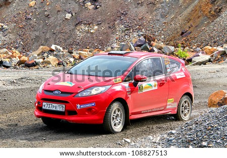 BAKAL, RUSSIA - JULY 21: Sergey Solntsev's Ford Fiesta (No. 20) competes at the annual Rally Southern Ural on July 21, 2012 in Bakal, Satka district, Chelyabinsk region, Russia.