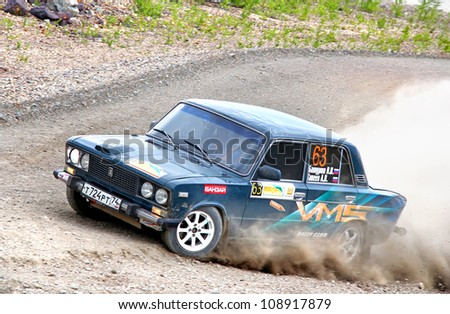 BAKAL, RUSSIA - JULY 21: Vladimir Baturin's VAZ-2106 (No. 63) competes at the annual Rally Southern Ural on July 21, 2012 in Bakal, Satka district, Chelyabinsk region, Russia.