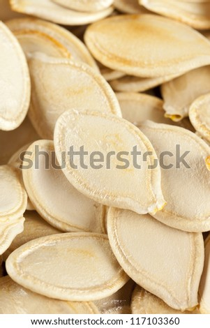 Baked and Salted Pumpkin Seeds on a background