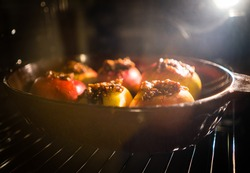baked apple baking in oven at kitchen