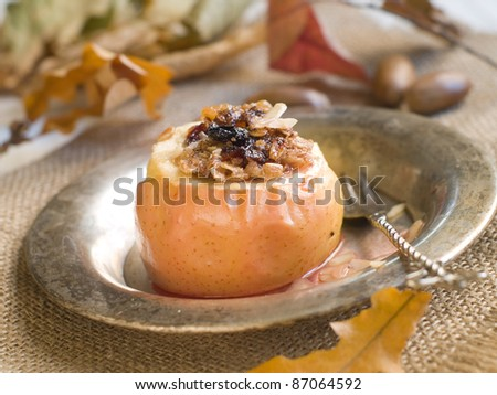 Baked apple with oatmeal and nut. Selective focus - stock photo
