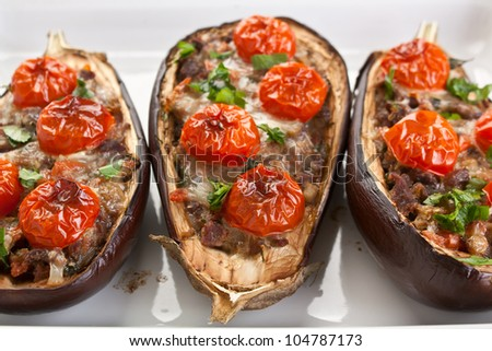 baked aubergines stuffed with cheese , meat and vegetables