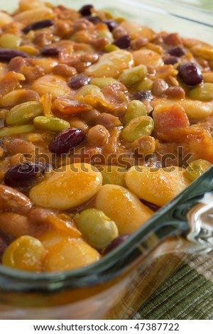 Baked bean casserole with butter beans, lima beans, kidney beans, white navy beans, and bacon.