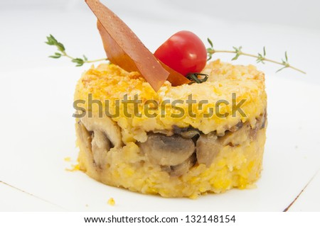 baked beans and mushrooms on white plate in a restaurant - stock photo