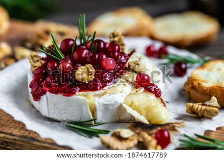 Baked Camembert brie with fresh rosemary and cranberry sauce. Gourmet appetizer. Breakfast, Food recipe background. Close up Сток-фото ©