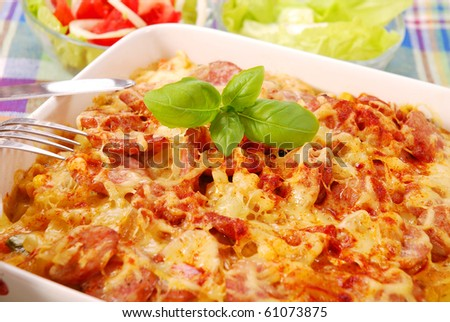 baked casserole with potato,sausage,onion and cheese