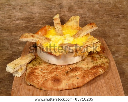 Baked cheese with rustic bread