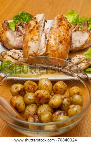 baked chicken and potatoes with mushrooms in a glass bowl